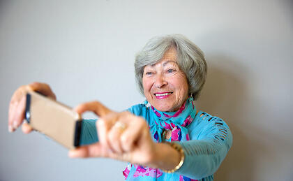 Senior woman taking selfie with her phone-2